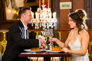 happy couple have a romantic date in a fine dining restaurant th